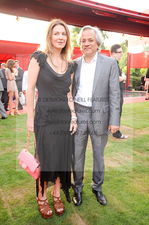 ANISH KAPOOR and his wife SUZANNE at the annual Serpentine Gallery Summer party this year sponsored by Jaguar held at the Serpentine Gallery, Kensington Gardens, London on 8th July 2010.  2010 marks the 40th anniversary of the Serpentine Gallery and the 10th Pavilion.