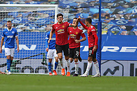 Football - 2020 / 2021 Premier League - Brighton and Hove Albion vs. Manchester United<br /> <br /> Harry Maguire of Manchester United celebrates his equaliser with Mason Greenwood of Manchester United during the Premier League match at The Amex Stadium Brighton <br /> <br /> COLORSPORT/SHAUN BOGGUST