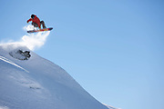 A male snowboarder in La Plagne ski resort in the French Tarentaise Valley