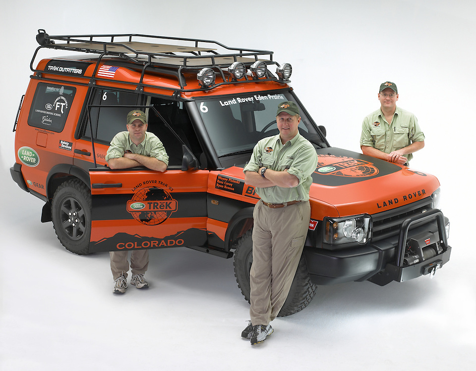 Land Rover Eden Prairie's Trek team 2003 pose in front of their Land Rover Discovery at the studio after winning the competition pitting teams from other Land Rover dealers in off road driving, navigation, and mechanics.
