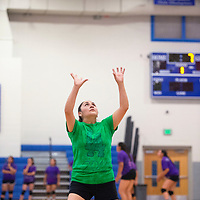 """Shawna Douma, a 2001 Laguna-Acoma graduate sets the ball for the alumni team Tuesday evening while participating in """"Meet the Hawks"""" at Laguna-Acoma Jr./Sr. High School. After graduation Douma played volleyball for Haskell Indian Nations University."""