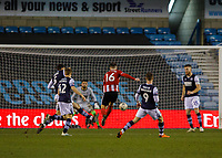 Football - 2019 / 2020 Emirates FA Cup - Fourth Round: Millwall vs. Sheffield United<br /> <br /> Ollie Norwood (Sheffield United) drives home his teams second goal at The Den.<br /> <br /> COLORSPORT/DANIEL BEARHAM