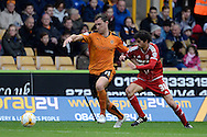 Middlesbrough striker Diego Fabbrini and Wolverhampton Wanderers midfielder Kevin McDonald battle during the Sky Bet Championship match between Wolverhampton Wanderers and Middlesbrough at Molineux, Wolverhampton, England on 24 October 2015. Photo by Alan Franklin.