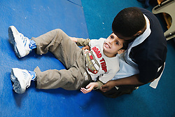Child with physical and learning disabilities exercising,