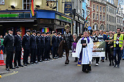 Members of the London Fire Brigade stand to attention as the LGBTI communinty lead by Fr Simon Buckley march from the Admiral Duncan pub to a memorial service in St Annes Gardens in Soho in London, England, United Kingdom on 30th April 2019.Twenty years since a Neo-Nazi set of a nail bomb at the Admiral Duncan pub a iconic gay venue in Soho killing three people and wounded 79. Four of the survivors had to have limbs amputated.