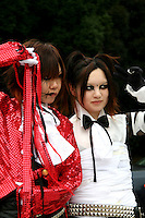 """Costume Play Goth Lolitas. A wide variety of """"costume play"""" getups takes in goths, goth lollys, cartoon characters from Japanese manga, anime,  the sweet-and-innocent frilly look or combinations in between. Each and every Sunday these cosplay characters converge on Harajuku Tokyo's fashion district. Most casual observers say that cosplay is a reaction to the rigid rules of Japanese society. But since so many cosplay kids congregate in Harajuku and Aoyama - Tokyo headquarters of Fendi, Hanae Mori and Issey Miyake, others consider it is a reaction to high fashion. Whatever the cause, cosplay aficionados put a tremendous amount of effort into their costumes every Sunday. Though one does wonder what they wear on Monday morning..."""