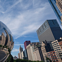 """Chicago seen from """"The Bean"""" Cloud Gate sculpture by artist Anish Kapoor in Millennium Park looking south along Michigan Avenue."""