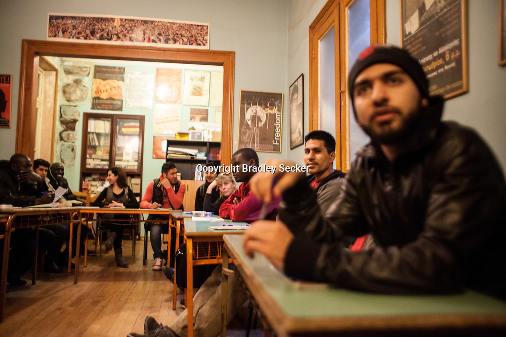 English lessons and songs are taught to migrants and refugees in Athens. Classes run by a cultural centre to promote language, cultural understanding and assist those living in Greece