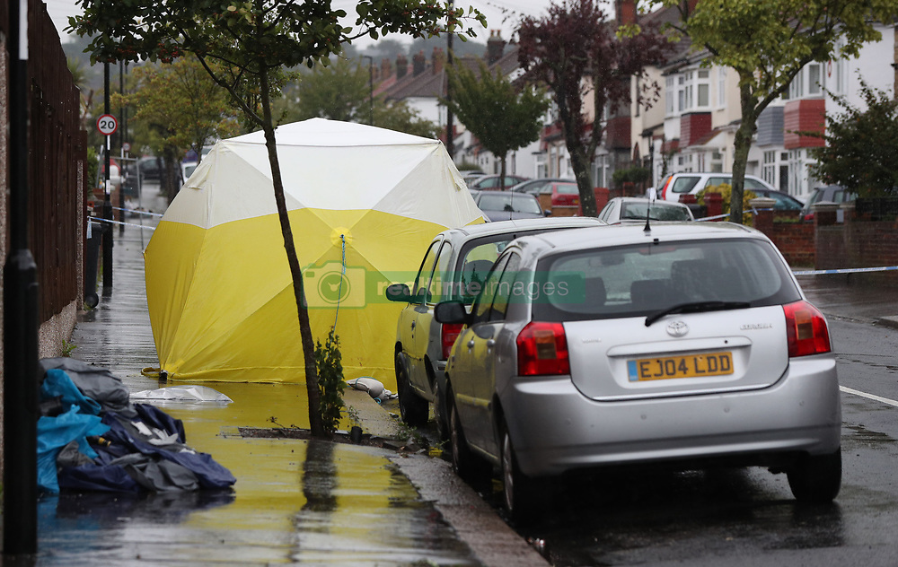 A police forensics tent at the scene in Thornton Heath, south London, where a 15-year-old boy was stabbed to death last night.