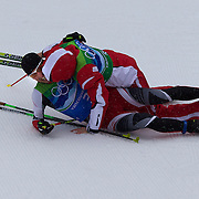 Winter Olympics, Vancouver, 2010.Mario Stecher, Austria, wins the Gold Medal for his team  and is crash tackled in celebration after the finish by team mate David Kreiner during the Nordic Combined Team/4X5KM competition at Whistler Olympic Park , Whistler, during the Vancouver Winter Olympics. 23rd February 2010. Photo Tim Clayton