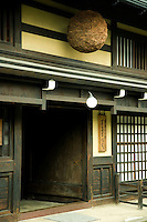 Sake brewery in the Sanmachi or Furui-machi District of Takayama, an area where Edo period houses remain in traditional buildings of sake breweries and merchants houses. The ball, made of cedar over the door lets customers know the season's sake is ready for purchase and drinking.  The district was designated an area of important traditional buildings by the Japanese Government and the movie set for many a Samurai movie.