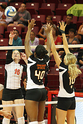 01 September 2012:  Shannon McGlaughlin mounts an attack while Arica Nassar and Megan McBride defend during an NCAA womens volleyball match between the Oregon State Beavers and the Illinois State Redbirds at Redbird Arena in Normal IL