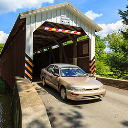 Strasburg, PA - June 8, 2012: The Lime Valley Covered Bridge or Strasburg Bridge spans the Pequea Creek in Lancaster County, PA.