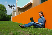 A student of the Ugent, university of Ghent, operates a drone that will be used for geopgraphical mapping in crisis area, ghent, Belgium, 12.05.2016