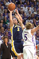 Marquette guard Carolyn Kieger (2) scores over Kansas State's Shalee Lehning (5), during the first half of the WNIT Finals at Bramlage Coliseum in Manhattan, Kansas, March 31, 2006.   Marquette leads K-State 39-38 at halftime.