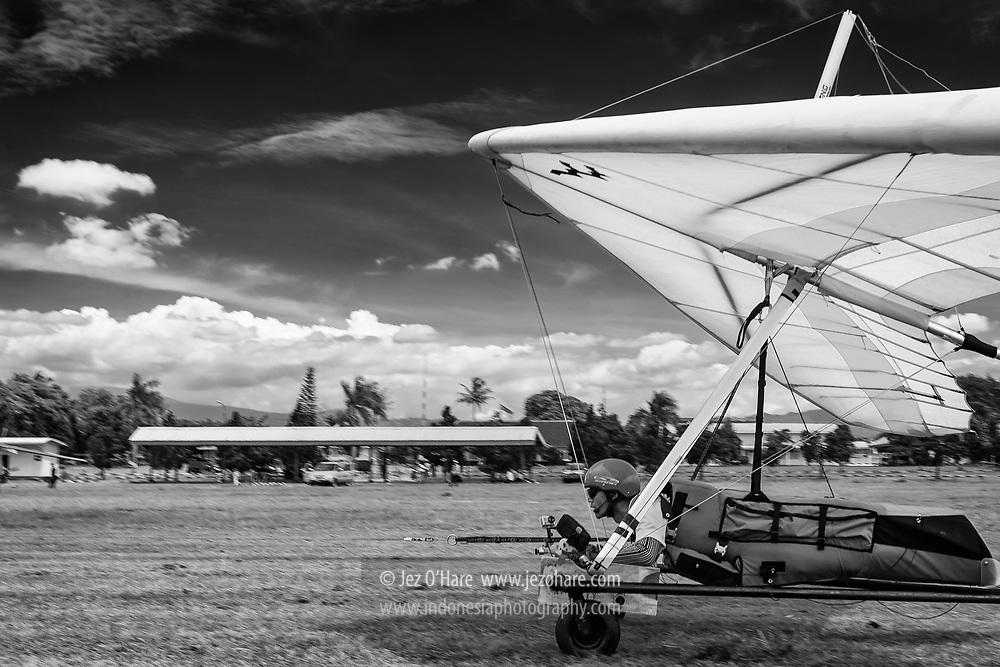 Koesnaidi Bohon, Indonesian hang gliding champion & instructor. Towing launch at HUT FASI, Lanud Sulaiman, Bandung, West Java, Indonesia