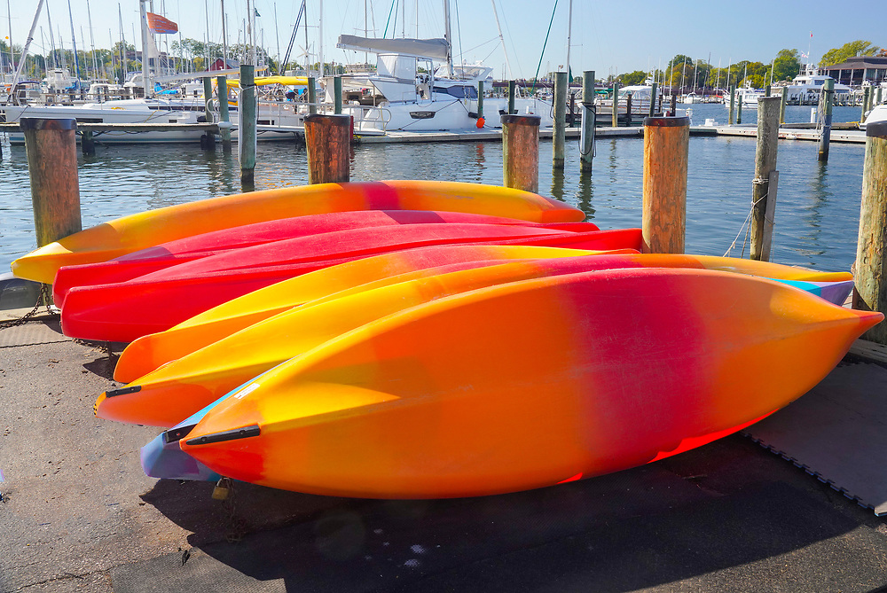 Bright orange, red and yellow kayaks