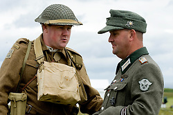 Home Guard reenactor(left) and a Reenactor portraying an officer from Feldgendarmerie (Field Police)at Scarborough Castle, Sunday 30th May 2010<br /> Image © Paul David Drabble.