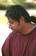 Thoughtful man age 32 at the Asian American Festival. Harriet Island St Paul Minnesota USA