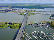 Nederland, Noord-Holland, Amsterdam, 07-05-2021; Ring A10 Oost overgaand in Ringweg Noord, gezien naar eiland Zeeburg (Zeeburger eiland) met ingang Zeeburgertunnel. In de voorgrond Nieuwe Diep en Diemerzeedijk met Gemeenlandshuis.<br /> Ring A10 East changes into Ringweg Noord, looking towards island Zeeburg (Zeeburger island) with entrance Zeeburgertunnel. In the foreground Nieuwe Diep and Diemerzeedijk with Gemeenlandshuis.<br /> <br /> luchtfoto (toeslag op standaard tarieven);<br /> aerial photo (additional fee required)<br /> copyright © 2021 foto/photo Siebe Swart