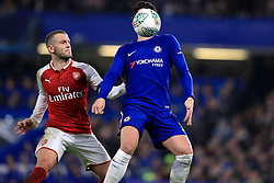 Chelsea's Alvaro Morata (front) and Arsenal's Jack Wilshere battle for the ball during the Carabao Cup Semi Final, First Leg match at Stamford Bridge, London.
