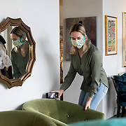 """CHARLOTTE NC - MAY 8:  Kaitlyn Summer, an employee at Slate Interiors, stages a scene to photograph for Instagram at the shop in Charlotte, NC on May 8, 2020. Even though commercial businesses that were deemed """"non-essential"""" are able to reopen at 5pm on May 8th under North Carolina Governor, Roy Cooper's phase 1 plan to reopen the state economy, Teri Garner, owner of Slate says that they will stay by appointment only for the foreesable future.  (Logan Cyrus/ Bloomberg )"""