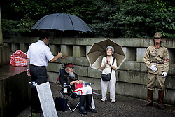 August 15, 2017 - Tokyo, Japan - Japanese wear imperial army uniforms at the Yasukuni Shrine in Tokyo, Japan. Japan marks the 72nd anniversary of the end of the World War II on 15 August. Some 3.1 million Japanese soldiers and civilians were killed during the war, almost 2.5 million of whom are enshrined at Yasukuni, including convicted WWII war criminals. (Credit Image: © Alessandro Di Ciommo/NurPhoto via ZUMA Press)