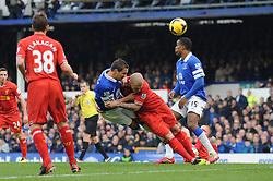 Everton's Phil Jagielka heads the ball towards goal - Photo mandatory by-line: Dougie Allward/JMP - Tel: Mobile: 07966 386802 23/11/2013 - SPORT - Football - Liverpool - Merseyside derby - Goodison Park - Everton v Liverpool - Barclays Premier League