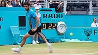 Tennis - 2019 Queen's Club Fever-Tree Championships - Day Seven, Sunday<br /> <br /> Men's Singles Final: Feliciano Lopez (ESP) Vs. Gilles Simon (FRA)<br /> <br /> Gilles Simon (FRA) with a cheeky through the leg return on Centre Court.<br />  <br /> COLORSPORT/DANIEL BEARHAM