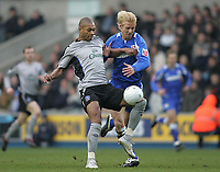 Photo: Lee Earle.<br /> Millwall v Everton. The FA Cup. 07/01/2006. Everton's Marcus Bent (L) battles with Zak Whitbread.
