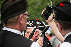 © Licensed to London News Pictures . 29/08/2015 . Manchester , UK . Tuning the bagpipes . Manchester Gay Pride parade through Manchester City Centre . Photo credit : Joel Goodman/LNP