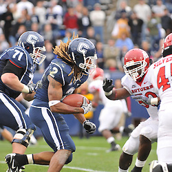 Oct 31, 2009; East Hartford, CT, USA; Connecticut running back Andre Dixon (2) runs on a goalline attempt with the score 21-17 late during  second half Big East NCAA football action in Rutgers' 28-24 victory over Connecticut at Rentschler Field.
