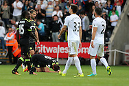 John Terry of Chelsea (on ground) slumps injured at the end of the match after the final whistle is blown.Premier league match, Swansea city v Chelsea at the Liberty Stadium in Swansea, South Wales on Sunday 11th Sept 2016.<br /> pic by  Andrew Orchard, Andrew Orchard sports photography.