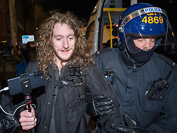 """© Licensed to London News Pictures;26/03/2021; Bristol, UK. A man live-streaming to YouTube under the name ANGEL CAMORRA is arrested by police at a third """"Kill the Bill"""" protest in Bristol on Friday night this week taking place against the Police, Crime, Sentencing and Courts Bill. Angel Camorra live-streams during the arrest which officers say is for suspicion of violent disorder at the protest in Bristol last weekend on Sunday night, which Angel Camorra denies saying he was not there. The Police, Crime, Sentencing and Courts Bill proposes new restrictions on protests. Photo credit: Simon Chapman/LNP."""