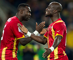 John Mensah of Ghana and Stephen Appiah of Ghana during the overtime at  2010 FIFA World Cup South Africa Quarter Finals football match between Uruguay and Ghana on July 02, 2010 at Soccer City Stadium in Sowetto, suburb of Johannesburg. Uruguay defeated Ghana after penalty shots. (Photo by Vid Ponikvar / Sportida)