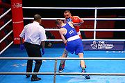Istvan Szaka of Hungary (red) and Brendan Irvine of Ireland (bue) competing in the Men's Flyweight preliminaries during The Road to Tokyo European Olympic Boxing Qualification, Sunday, March 15, 2020, in London, United Kingdom. (Mitchell Gunn-ESPA-Images/Image of Sport)
