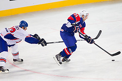 Owen Fussey of Great Britain vs Robert Sabolic of Slovenia during ice-hockey match between Great Britain and Slovenia at IIHF World Championship DIV. I Group A Slovenia 2012, on April 15, 2012 in Arena Stozice, Ljubljana, Slovenia. (Photo by Vid Ponikvar / Sportida.com)
