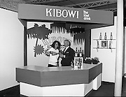 """The Dublin Horse Show   (R39)..1986..07.08.1986..08.07.1986..7th August 1986..At the Dublin Horse Show, Irish Distillers presented a new drink to the Irish marked. They displayed the drink 'Kibowi', the Kiwi drink on their specially commissioned stand. where passers by could sample it..Irish Distillers also sponsored a """"Drinks'"""" evening for their invited guests at the hall in the RDS. the .Images show the """"Kibowi'' stand and the guests at the reception."""