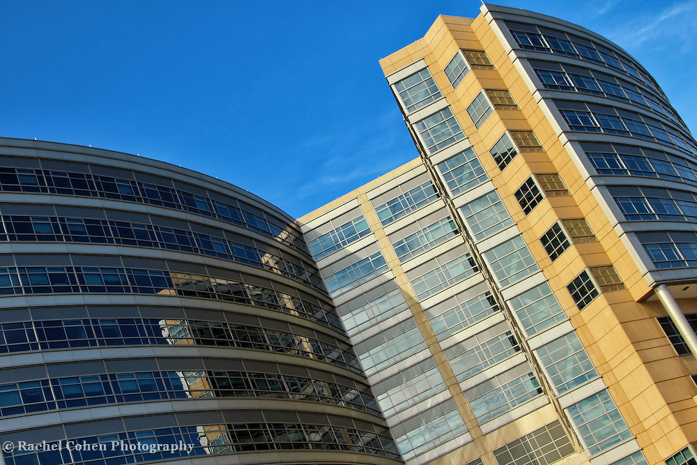 """""""Reflections on a Curve""""<br /> <br /> Lovely colors and reflections set at an angle, and curve on The C.S. Mott Children's Hospital in Ann Arbor Michigan!!<br /> <br /> Architecture: Structures, buildings and their details by Rachel Cohen"""