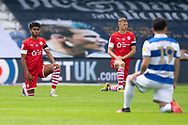 Queens Park Rangers and Barnsley players briefly take the knee before the EFL Sky Bet Championship match between Queens Park Rangers and Barnsley at the Kiyan Prince Foundation Stadium, London, England on 20 June 2020.
