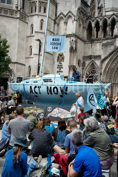Extinction Rebellion supporters park a blue boat, named the Polly Higgins in memory of the lawyer who fought for ecocide to be made a crime in front of the Royal Courts of Justice on the Strand on July 15th 2019 in London, United Kingdom. Last week it was announced that over 1000 activists who were arrested in the April protests face prosecution.