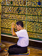 18 NOVEMBER 2017 - YANGON, MYANMAR: A man prays at Botataung Pagoda in Yangon. Pope Francis is visiting Myanmar, September 27-30. It will be the first visit by a Pope to the overwhelmingly Buddhist nation. He will meet with the Aung San Suu Kyi and other political leaders and will participate in two masses in Yangon. The Pope is expected to talk about Rohingya issue while he is in Myanmar. The Rohingya are persecuted Muslim minority in Rakhine state in western Myanmar. It's not clear how Myanmar's politically powerful nationalist monks will react if the Pope openly talks about the Rohingya. In the past, the monks have led marches and demonstrations against foreign diplomatic missions when foreign ambassadors have spoken in defense of the Rohingya. There is not much visible sign of the Pope's imminent visit in Yangon, which is estimated to be more than 90% Buddhist.     PHOTO BY JACK KURTZ