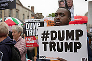 Protests continue in the rain against the state visit of US President Donald Trump on 4th June 2019 in London, United Kingdom. Organisers Together Against Trump which is a collaboration between the Stop Trump Coalition and Stand Up To Trump, have organised a carnival of resistance, a national demonstration to protest against President Trump's policies and politics during his official UK visit.