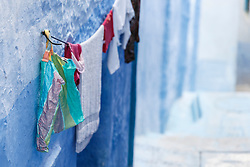 Laundry drying against blue wall, Chefchaouen, Morocco