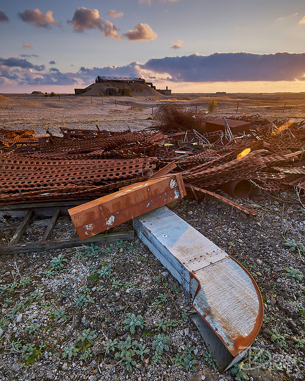 Scrap metal and industrial detritus litter the site of the former Atomic Weapons Research Establishment on the shingle spit at Orford Ness in Suffolk.