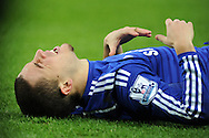 Chelsea player Eden Hazard lies injured . Barclays Premier League match, Swansea city v Chelsea at the Liberty Stadium in Swansea, South Wales on Saturday 17th Jan 2015.<br /> pic by Andrew Orchard, Andrew Orchard sports photography.