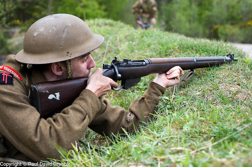Reenactor from Northern World War Two Association, portraying the 5th Battalion, East Yorkshire, waits to ambush German troops during a private 24hr excerise.<br /> Sutton Grange, near Ripon Yorkshire 15  May 2010. Images © Paul David Drabble.