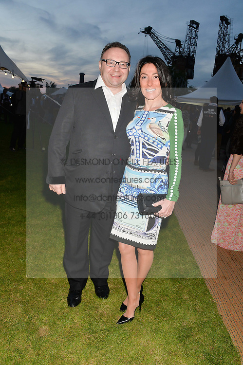 JONATHAN SHALIT and his wife KATRINA SHALIT at the Battersea Power Station Annual Party at Battersea Power Station, 188 Kirtling Street, London SW8 on 30th April 2014.