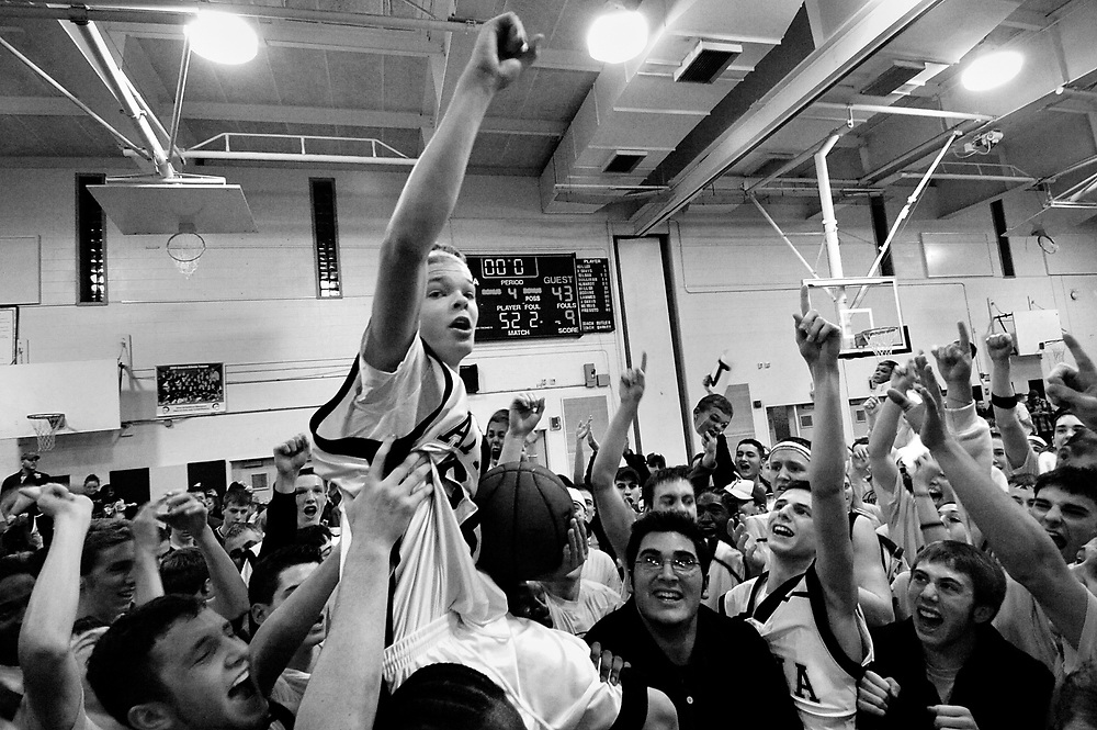 Team manager Jason McElwain is hoisted up by his teammater after his 20-point performance in the last four minutes of the last home game against Spencerport High on Wednesday, February 15.  Athena earned a three-way share of the Monroe County Division II basketball title by defeating Spencerport 79-43, thanks in part to the 20-point eruption by McElwain.  McElwain who has autism and has been the team manager of Athena for the past two seasons.