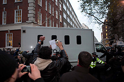 ©London News Picures. The van containing Julian Assange. Wikileaks's founder Julian Assange arriving at Westminster magistrate court in London on 7 December. Photo credit should read Fuat Akyuz/London News Pictures.